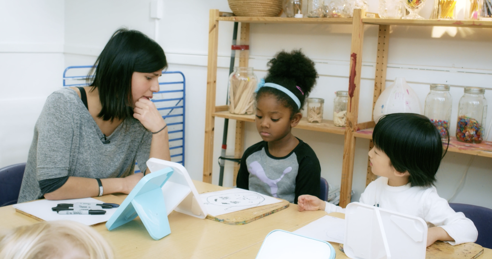 screenshot of film Anti-Bias Education in Action with educator talking with two children